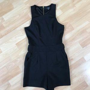 XOXO Black Sleeveless Romper. Decorative Zipper.
